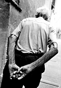 Man walking with joined hands - Montalcino (SI) - Italy, 1999
